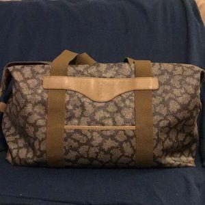 Trend Alert!! YSL abstract leopard weekend bag